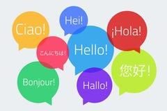 色的讲话起泡与文本你好在另外语言 免版税库存照片