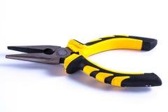 黄色的钳子和工作的黑颜色 库存图片