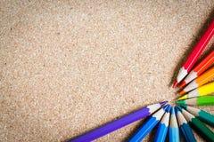 色的铅笔有棕色背景 库存图片