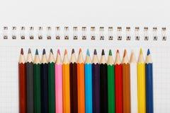 色的铅笔的一汇集在笔记本的 免版税图库摄影