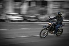 色的骑自行车的人 库存照片