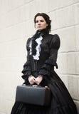 黑色的维多利亚女王时代的夫人 免版税库存照片