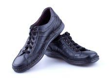 黑色皮革人s鞋子 免版税库存照片