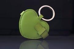 绿色皮革小装饰品 免版税库存照片