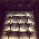 黑色皮革扶手椅子 库存照片