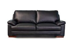 黑色皮革沙发 免版税图库摄影