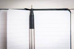黑色皮革笔记本 免版税库存照片