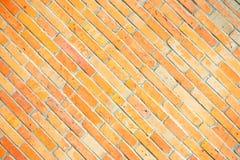黄色砖倾斜的纹理背景 免版税库存图片