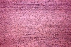紫色砖墙作为设计的背景 免版税库存图片