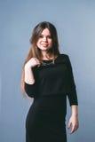 黑色礼服女孩摆在 图库摄影