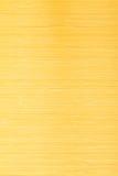 黄色竹席子镶边背景纹理 库存图片