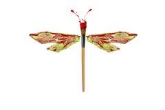 绿色红色白色油漆做了蜻蜓 免版税图库摄影