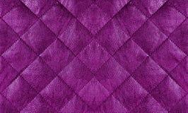 紫色缝制了皮革织品关闭,背景 免版税库存照片
