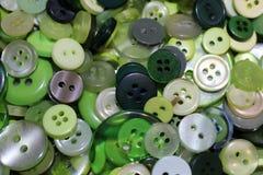 绿色缝合的按钮的混杂的收藏 免版税库存图片