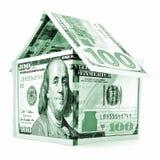 绿色美元房子,在白色背景隔绝的金钱大厦 免版税库存照片