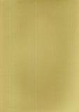 黄色背景的金属化的纸纹理 免版税图库摄影