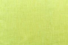 绿色背景豪华布料或难看的东西丝绸纹理缎天鹅绒波浪折叠  免版税库存图片