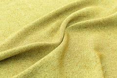 黄色背景豪华布料或难看的东西丝绸纹理缎天鹅绒波浪折叠  库存图片
