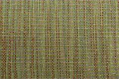 绿色背景豪华布料或难看的东西丝绸纹理缎天鹅绒波浪折叠  免版税库存照片