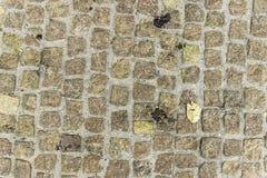 黄色自然石背景 免版税库存照片
