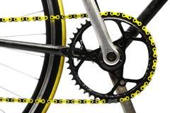 黄色自行车链子 免版税库存照片