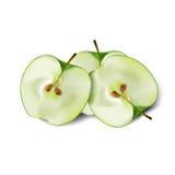 绿色苹果的段在轻的背景的 免版税图库摄影