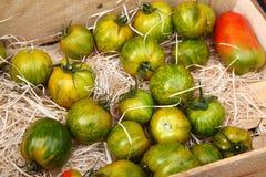 绿色蕃茄在市场上在芒通,法国 库存图片