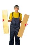 黄色衬衣的人在拿着两个委员会的总体 免版税库存图片