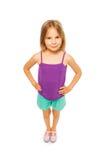 紫色衬衣的小俏丽的女孩 库存照片