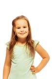 绿色衬衣的小逗人喜爱的女孩 图库摄影