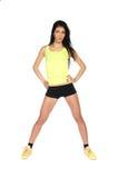 黄色衬衣的运动的女孩 免版税库存照片