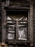 黑色被烧的窗口 图库摄影