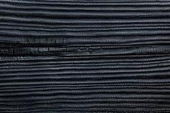 黑色被烧的&被烧焦的木雪松杉木议院房屋板壁背景 图库摄影