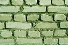 绿色被风化的砖墙纹理 免版税图库摄影