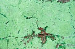 绿色被绘的墙壁损伤表面 免版税库存照片