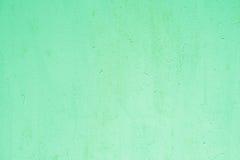 绿色被绘的墙壁纹理背景 免版税库存图片