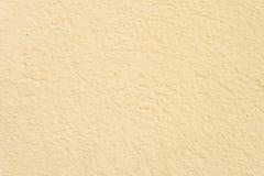 黄色被绘的墙壁背景 免版税图库摄影