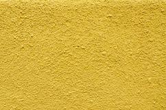 黄色被绘的混凝土墙纹理  库存图片