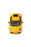 黄色赛跑的玩具汽车体育车儿童的礼物 免版税库存照片