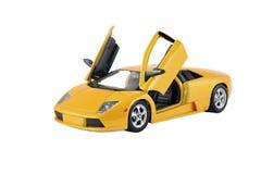 黄色赛跑的玩具汽车体育车儿童的礼物 库存图片
