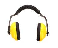 黄色运转的防护耳机 免版税库存照片