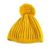 黄色钩针编织编织帽子 库存图片
