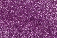 紫色闪闪发光关闭  库存照片