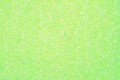 绿色难看的东西起了泡沫聚乙烯背景 免版税图库摄影