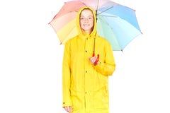 黄色雨衣的女孩 图库摄影