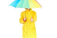 黄色雨衣的女孩 库存照片