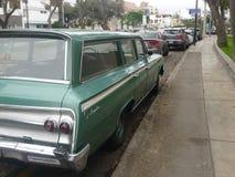 绿色雪佛兰因帕拉小型客车 库存图片