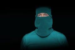 绿色面具的窃贼 库存照片