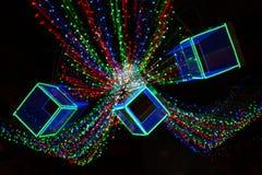 黄色,黑暗,红色,蓝色背景 在bokeh的圣诞灯 Boken 库存照片