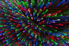 黄色,黑暗,红色,蓝色背景 在bokeh的圣诞灯 Boken 免版税库存照片